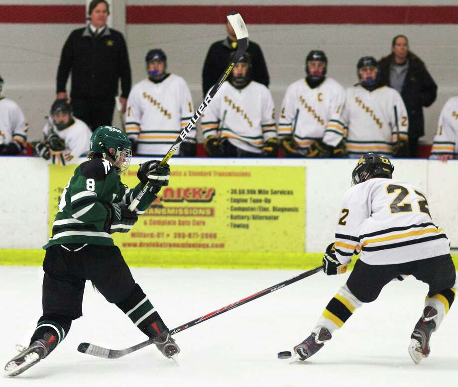 Blaine McMahon of the Green Wave fires a shot during New Milford High School ice hockey's Division II state tournament quarterfinal match vs. Amity Regional, March 2014 Photo: Trish Haldin / The News-Times Freelance