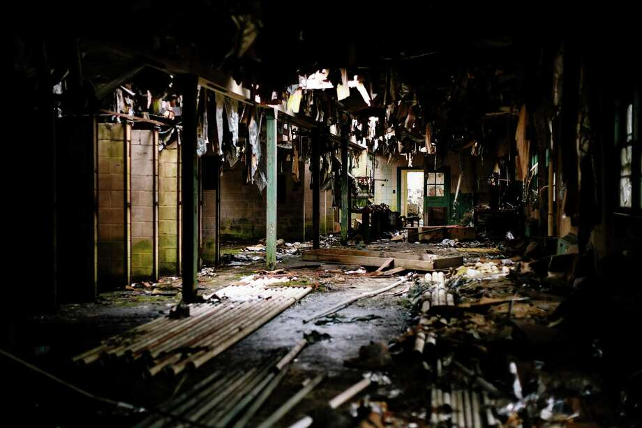 Refuse from numerous roof collapses litters the main room in one of three buildings within the former Nike Site S-13/14 missile site. Photo: JORDAN STEAD, SEATTLEPI.COM / SEATTLEPI.COM