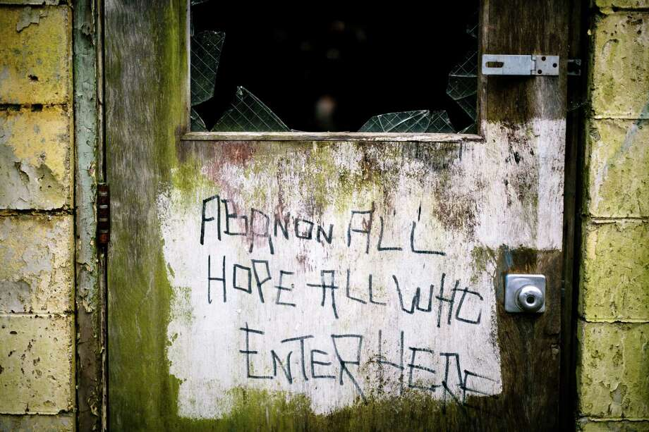 "A chilling, misspelled message warns passersby to ""abandon all hope all who enter here"" outside of a building within the former Nike Site S-13/14 missile site. Photo: JORDAN STEAD, SEATTLEPI.COM / SEATTLEPI.COM"