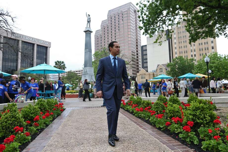 Mayor Julian Castro arrives for the City of San Antonio reopening of Travis Park ceremony, Monday, March 31, 2014. The event will run throughout the day and will culminate with a ticketed dinner in the evening. The city plans on holding exercise classes, and food trucks at the park throughout the year. Photo: JERRY LARA, San Antonio Express-News