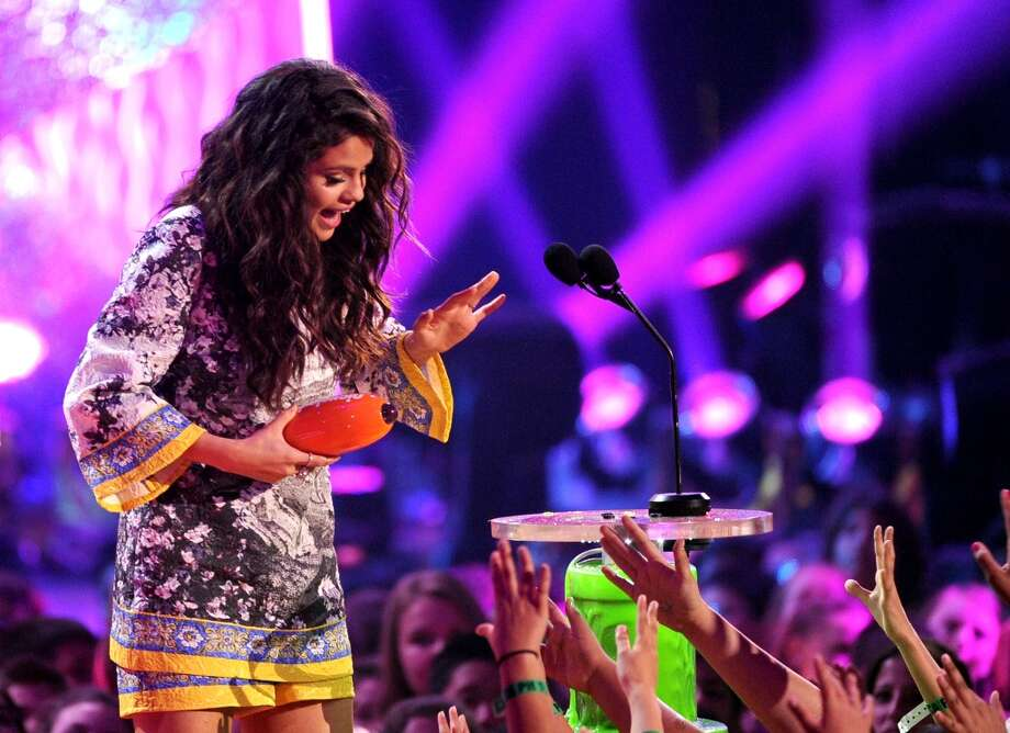 Singer Selena Gomez accepts the Favorite Female Singer award onstage during Nickelodeon's 27th Annual Kids' Choice Awards held at USC Galen Center on March 29, 2014 in Los Angeles, California. Photo: Kevin Winter, Getty Images