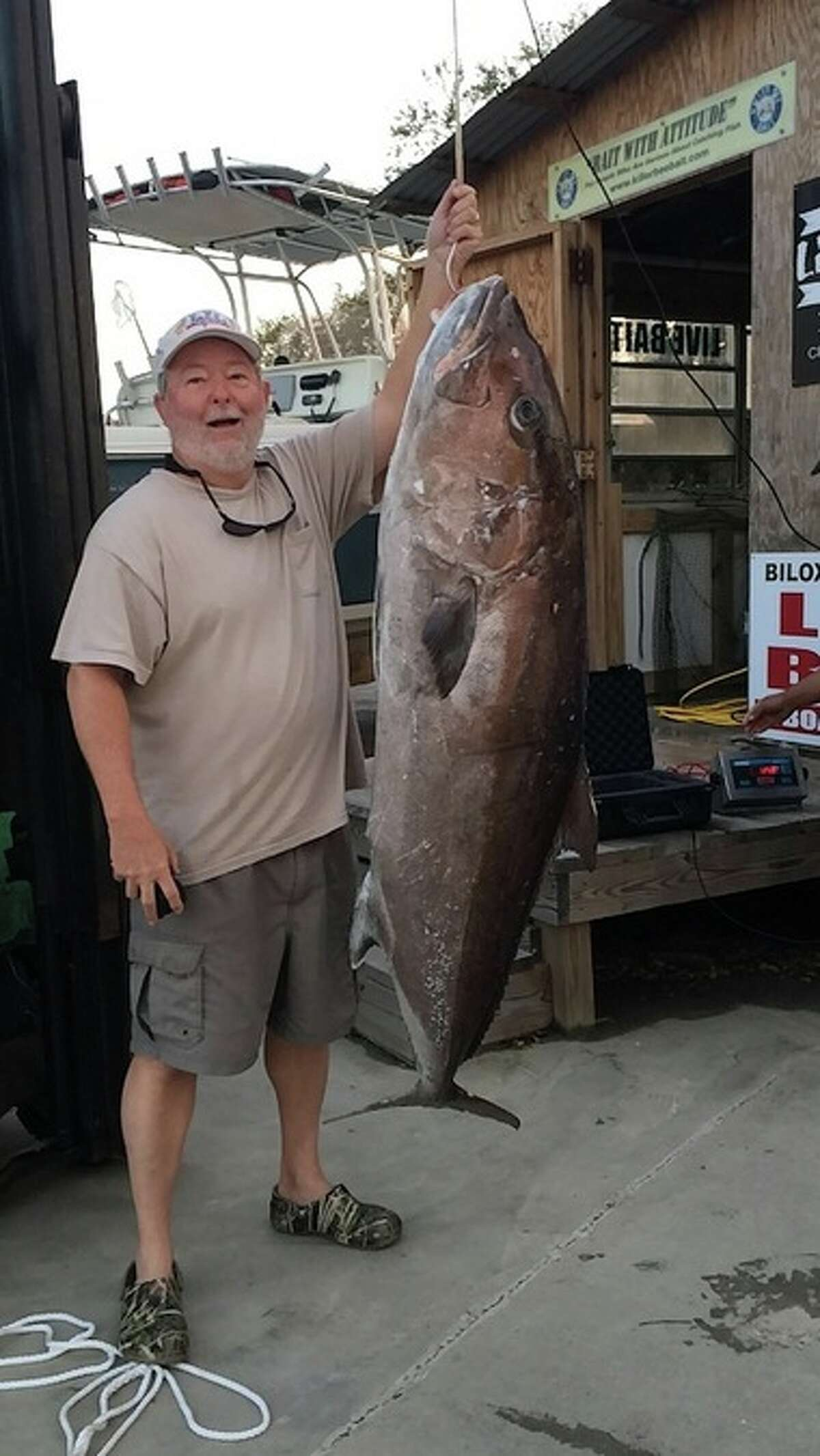 Don Wheeler of Laurel, Miss. holds up his record breaking catch, a 125lb 8oz Greater Amberjack.