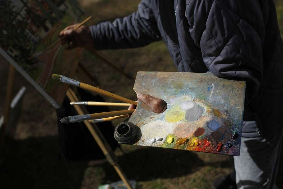 Expatriate's palette:Japan's Minoru Nagashima, 70, works on a painting at Lisbon's Torel public garden.   Nagashima has been choosing different outdoor spots of the Portuguese capital, often   gardens and parks, for his paintings since he settled down in Portugal 15 years   ago. Photo: Francisco Seco, Associated Press