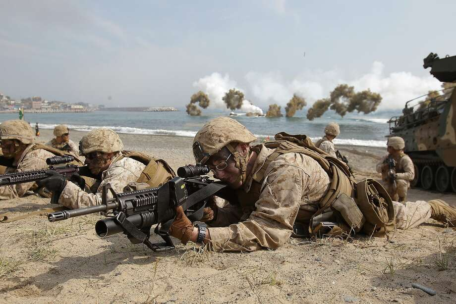U.S. Marines take aimafter hitting the beach at Pohang, South Korea, during a joint training operation with their South Korean counterparts. Photo: Chung Sung-Jun, Getty Images