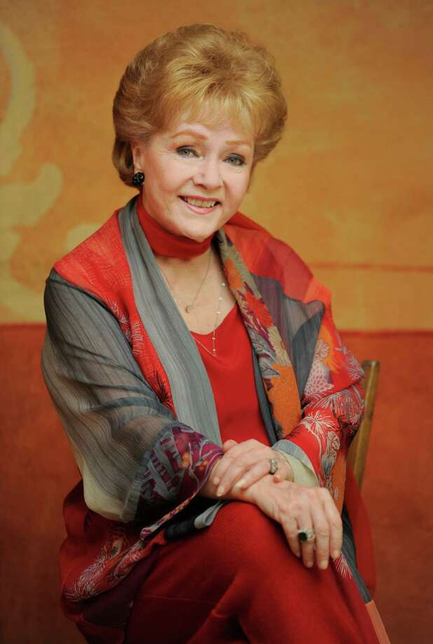 "In this Tuesday, May 21, 2013 photo, Debbie Reynolds, a cast member in the film ""Behind the Candelabra,"" poses for a portrait in Beverly Hills, Calif. Reynolds plays Frances, the mother of the pianist and vocalist, Liberace. HBO debuts A'A""Behind the CandelabraA'A"" in the US, Sunday, May 26, 2013. (Photo by Chris Pizzello/Invision/AP) Photo: Chris Pizzello / Invision"