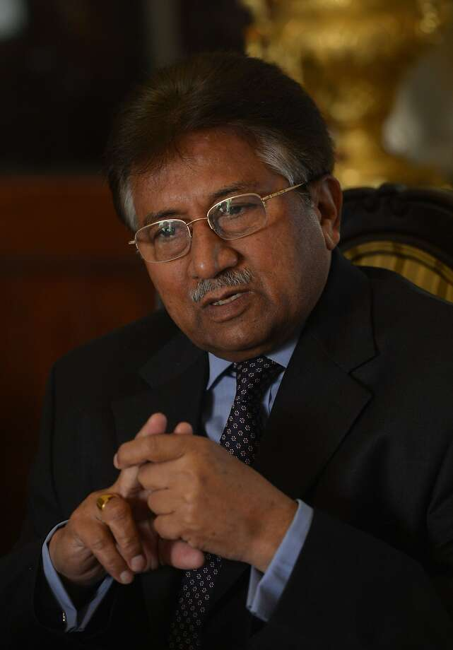 In this photograph taken on December 29, 2013, Pakistan's former military ruler Pervez Musharraf addresses foreign media representatives at his farmhouse in Islamabad.  A lawyer representing Pakistan's former military ruler Pervez Musharraf said January 5, 2014 the retired general would not make a scheduled appearance at his treason trial on Monday because of an ongoing illness.  AFP PHOTO/Farooq NAEEM/FILESFAROOQ NAEEM/AFP/Getty Images Photo: Farooq Naeem, AFP/Getty Images