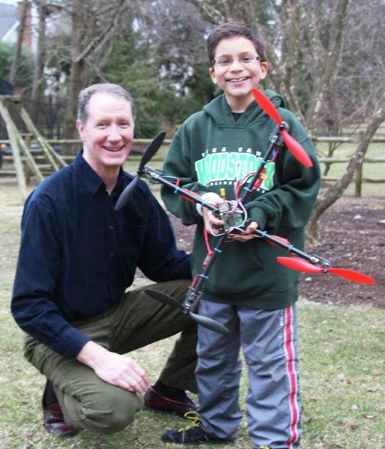 Mark Mathias and son Nick display the quadcopter drone they built. Westport CT. March 2014. Photo: Westport News/Contributed Photo / Westport News