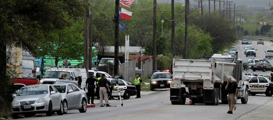 San Antonio police investigate Monday March 31,2014 at a scene on the 11,000 block of Leslie road where a truck hit a teen aged boy who was walking to school. Police said the boy was dragged 30-40 feet and is in critical condition. Photo: JOHN DAVENPORT, SAN ANTONIO EXPRESS-NEWS / ©San Antonio Express-News/Photo may be sold to the public