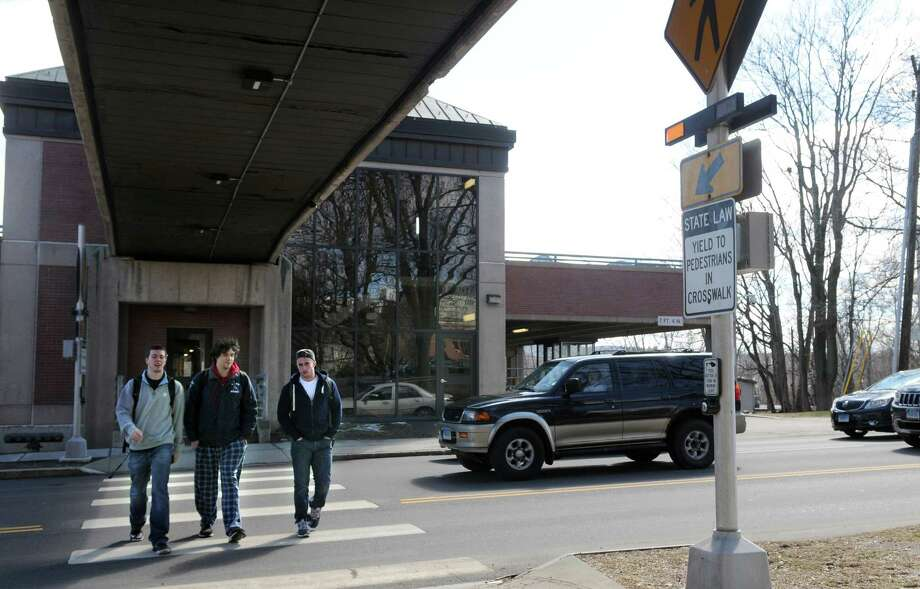 Students at Western Connecticut State University cross the street from the parking garage to the downtown campus on White Street Monday, March 31, 2014.on The White Street Task Force is getting ready to undertake the second phase of safety improvements along White Street in Danbury, Conn., in front of Western Connecticut State University's downtown campus. All of this is in response to a student killed crossing the road last year. Photos taken on White Street Monday, march 31, 2014. Photo: Carol Kaliff / The News-Times