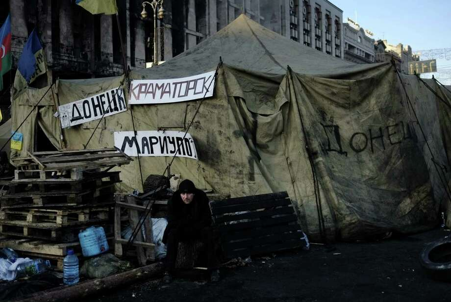 A protest camp remains in Kiev, Ukraine. The West has been indignant at Russian and Syrian moves. Ukrainians and Syrian civilians can do little with the West's indignation and passivity. Photo: Dimitar Dilkoff / Getty Images / AFP