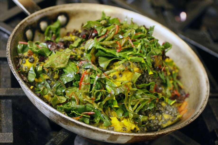 Kabocha squash alicha sautes in a pan at Radio Africa & Kitchen. Photo: Codi Mills, The Chronicle