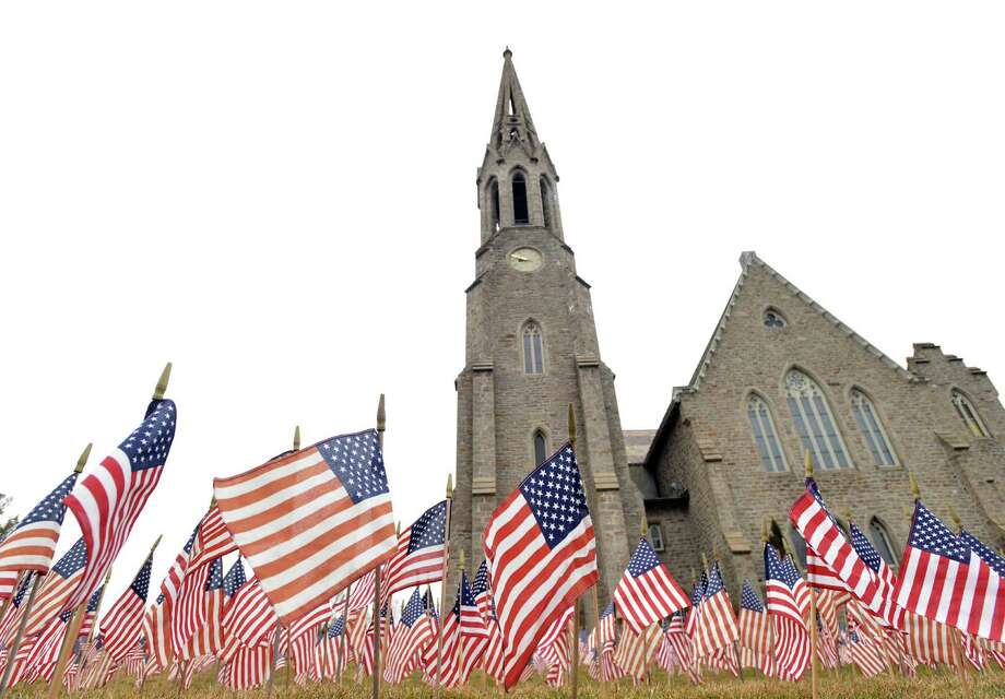 """The  installation """"Field of Flags"""" will be on display at Second Congregational Church in Greenwich until April 19. The project includes more than 7,000 flags. Photo: Bob Luckey / Greenwich Time"""