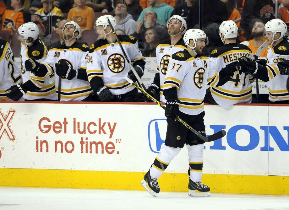 Mar 30, 2014; Philadelphia, PA, USA; Boston Bruins center Patrice Bergeron (37) celebrates his goal against the Philadelphia Flyers during the second period at Wells Fargo Center. Mandatory Credit: Eric Hartline-USA TODAY Sports Photo: Eric Hartline, Reuters