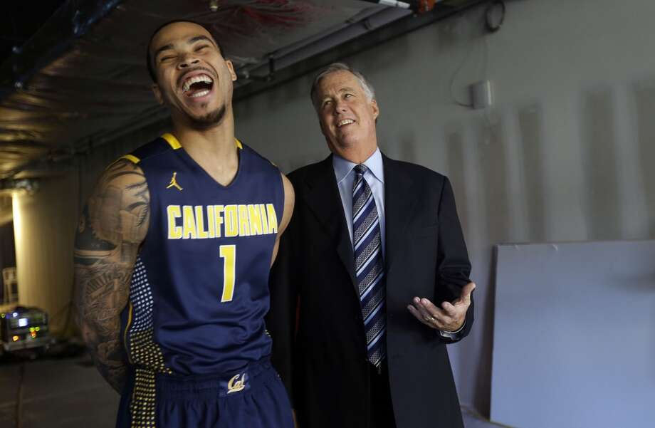 California's Justin Cobbs, left, jokes with head coach Mike Montgomery at the Pac-12 NCAA college basketball media day on Thursday, Oct. 17, 2013, in San Francisco. Photo: Marcio Jose Sanchez, Associated Press