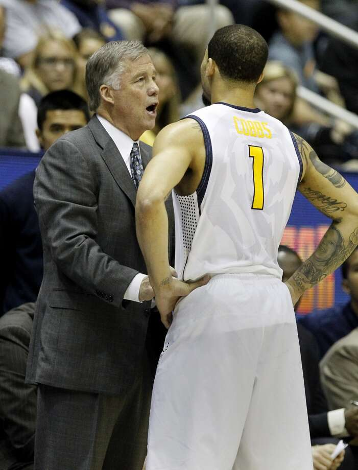 Cal head coach Mike Montgomery talked with leading Cal scorer Justin Cobbs late in the game. The Stanford Cardinal men's basketball team defeated the Cal Bears 80-69 Wednesday February 5, 2014 at Haas Pavilion in Berkeley, Calif. Photo: Brant Ward, The Chronicle