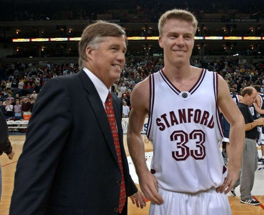 Stanford guard Matt Lottich is congratulated by head coach Mike Montgomery, left, after Stanford defeated Gonzaga 87-80 during the Pete Newell Challenge, Jan. 20, 2003 in Oakland, Calif. Photo: PAUL SAKUMA, AP