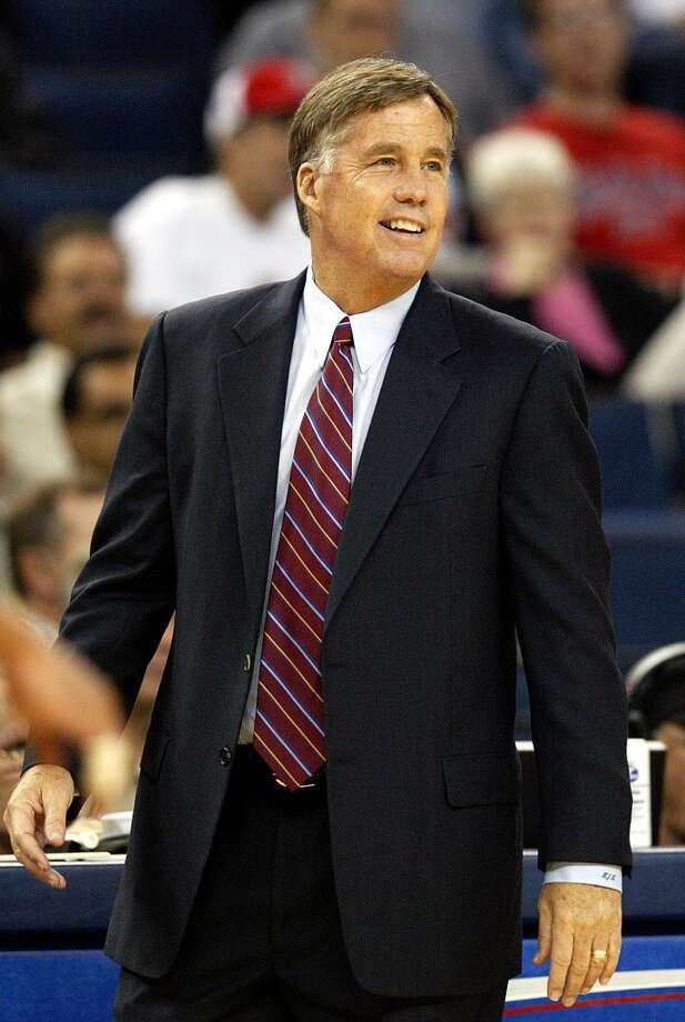 New Golden State Warriors coach Mike Montgomery smiles in the first quarter during a preseason game against the Portland Trail Blazers in Oakland, Calif., on Thursday, Oct. 14, 2004. Photo: JEFF CHIU, AP