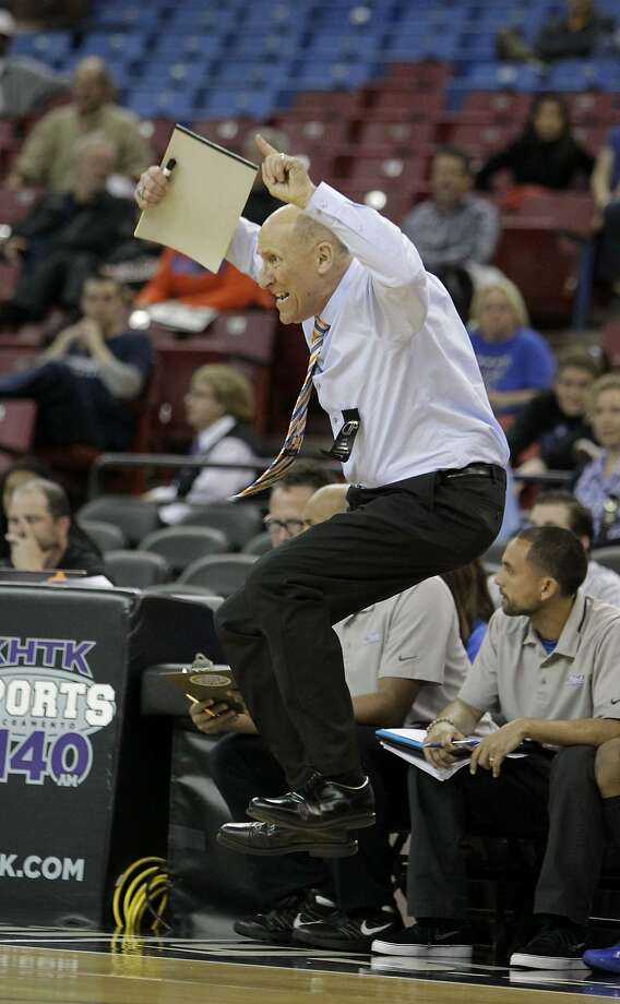 Don Lippi, head coach of the St. Joseph Notre Dame, jumps after not getting a foul called against Renaissance Academy during the fourth quarter of the boys' Division 5 CIF basketball championship game on Friday, March 28, 2014, in Sacramento, Calif. St. Joseph of Notre Dame won 57-32. (AP Photo/Rich Pedroncelli) Photo: Rich Pedroncelli, Associated Press
