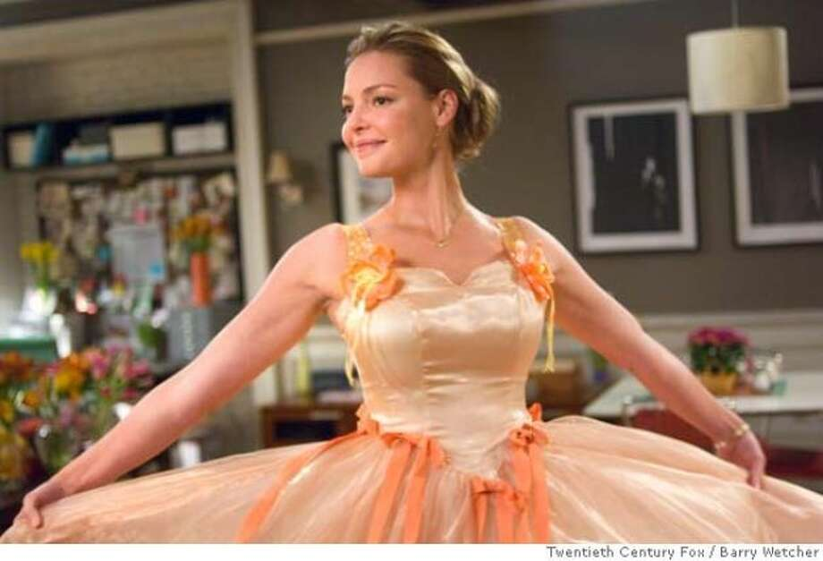 """'27 Dresses,'2008. This is what happens when you can't say """"no"""" to wearing ridiculous bridesmaids dresses 27 times."""