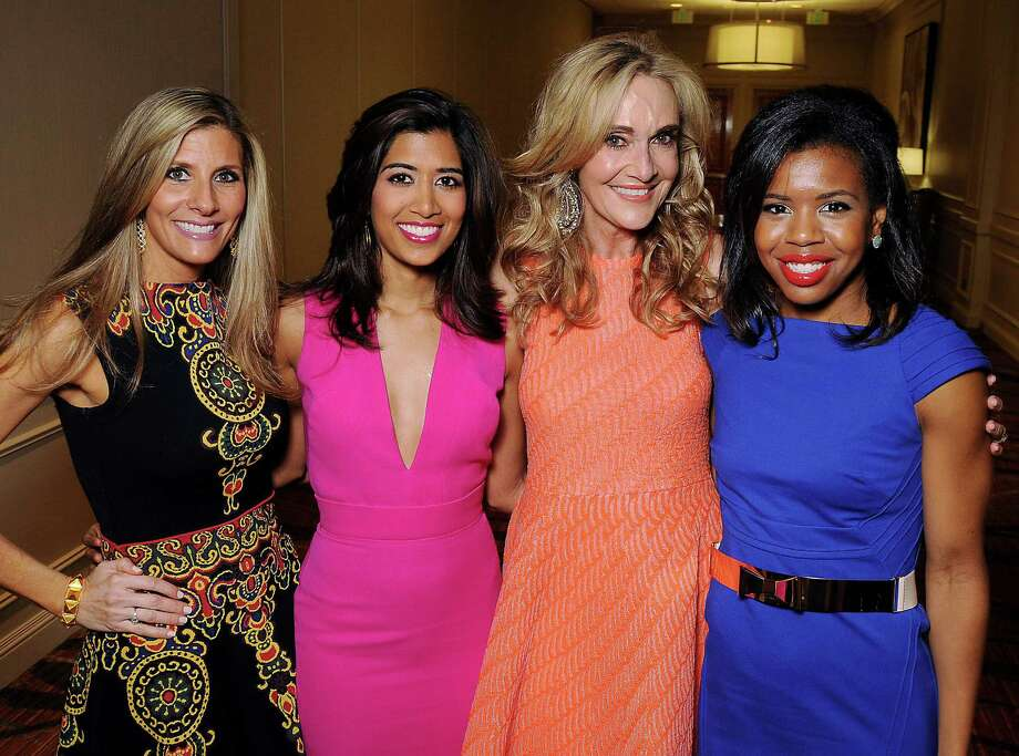 From left: Honorees Gina Bhatia, Divya Brown, Jana Arnoldy and Claire Cormier-Thielke at the Houston Chronicle's Best Dressed Luncheon at the Westin Galleria Hotel Friday March 28, 2014.(Dave Rossman photo) Photo: Dave Rossman, Freelance / Freelance