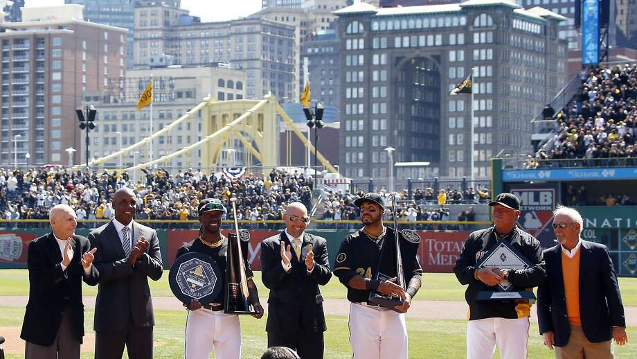 Former Pittsburgh standouts take part in a pregame ceremony at PNC Park honoring the Pirates' offseason award winners: Dick Groat (left), Barry Bonds, NL MVP and Silver Slugger winner Andrew McCutcheon, Jack Wilson, Silver Slugger winner Pedro Alvarez, Manager of the Year Clint Hurdle and Jim Leyland. Photo: Keith Srakocic, Associated Press