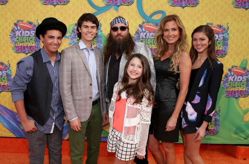 TV personality Willie Robertson  C  and wife Korie Robertson  R  with    Willie Robertson Willie Alexander Robertson