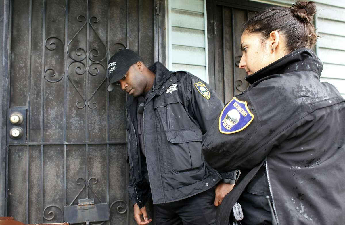 Richmond Police Officers Brandon Ruffin and Jennifer Cortez of the Bravo Unit check on the well being of a stroke victim that didn't answer the phone, Monday March 20, 2014, in Richmond, Calif.