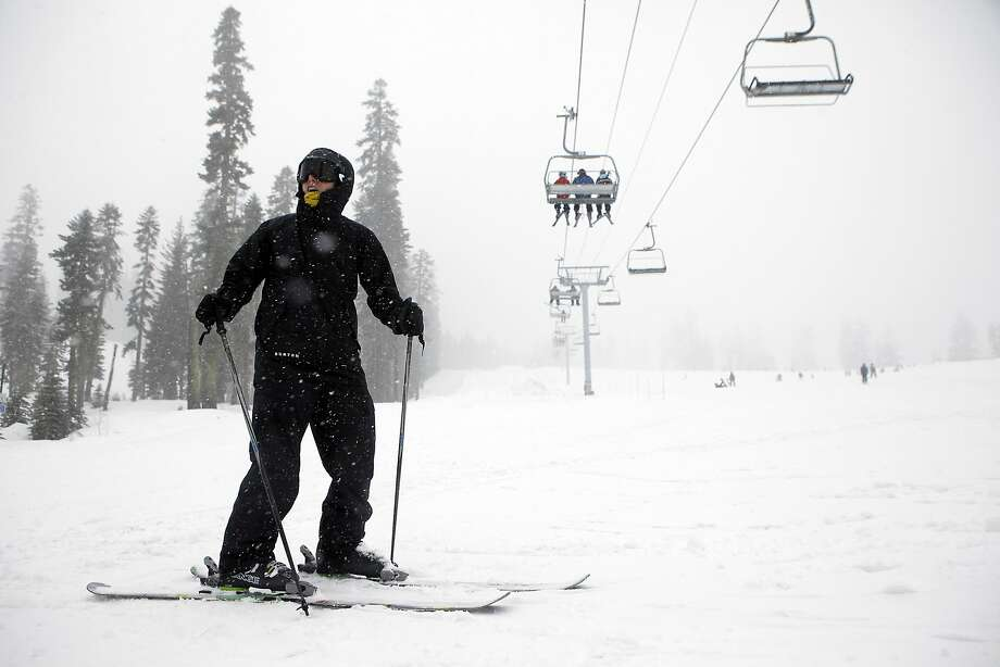 A skier stands at the bottom of a run at Tahoe ski resort in South Lake Tahoe in this March 2014 photo. Photo: Michael Short, The Chronicle