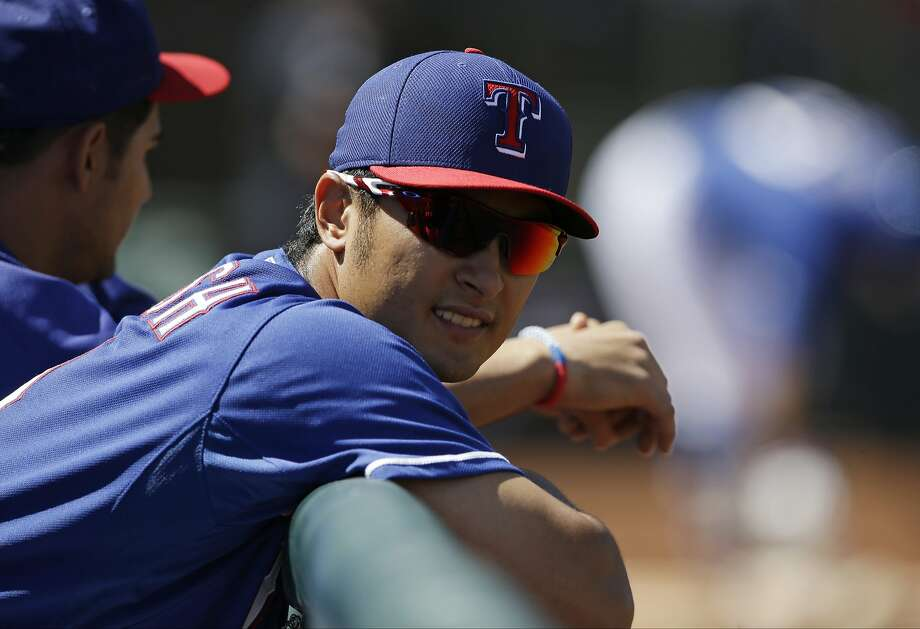 Texas Rangers starting pitcher Yu Darvish watches a spring exhibition baseball game against the Los Angeles Angels Wednesday, March 12, 2014, in Surprise, Ariz. (AP Photo/Darron Cummings) Photo: Darron Cummings, Associated Press