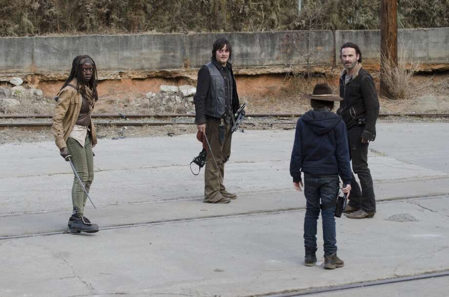 Michonne (Danai Gurira), Daryl Dixon (Norman Reedus), Rick Grimes (Andrew Lincoln) and Carl Grimes (Chandler Riggs) - The Walking Dead _ Season 4, Episode 16 - Photo Credit: Gene Page/AMC
