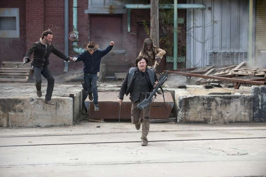 Rick Grimes (Andrew Lincoln), Carl Grimes (Chandler Riggs), Daryl Dixon (Norman Reedus) and Michonne (Danai Gurira) - The Walking Dead _ Season 4, Episode 16 - Photo Credit: Gene Page/AMC