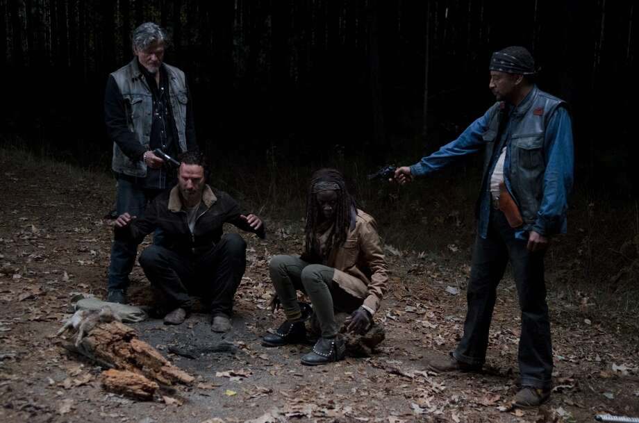 Keith Kober, Rick Grimes (Andrew Lincoln), Michonne (Danai Gurira) and Davi Jay - The Walking Dead _ Season 4, Episode 16 - Photo Credit: Gene Page/AMC