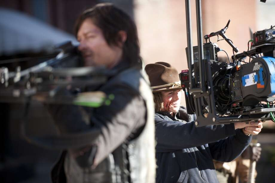 Norman Reedus and Chandler Riggs - The Walking Dead _ BTS - Season 4, Episode 16 - Photo Credit: Gene Page/AMC