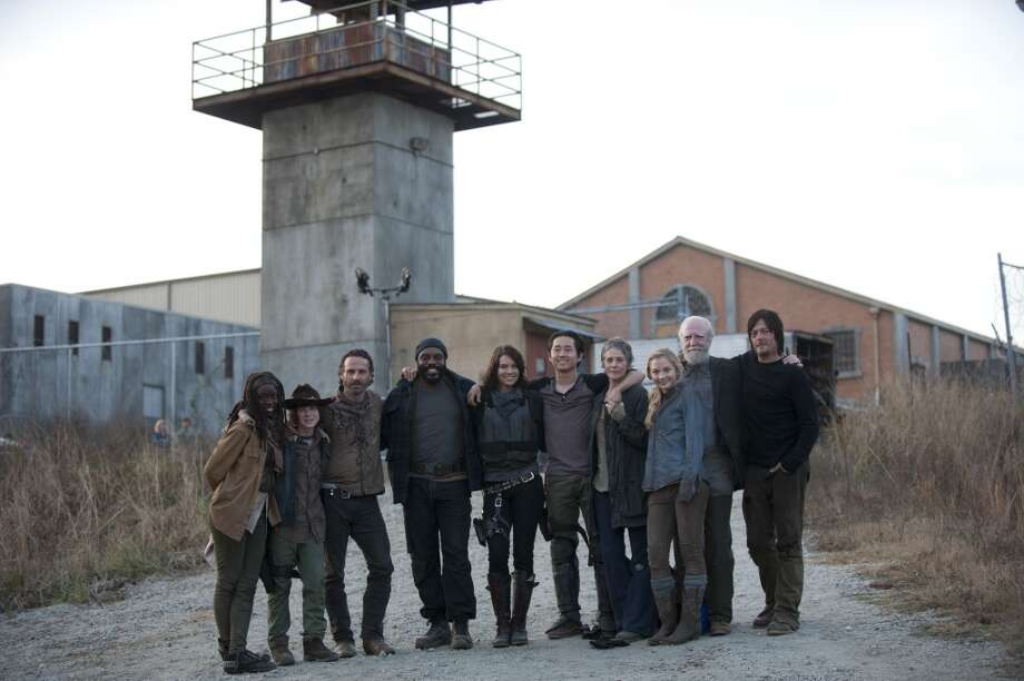 Danai Gurira, Chandler Riggs, Andrew Lincoln, Chad Coleman, Lauren Cohan, Steven Yeun, Melissa Suzanne McBride, Emily Kinney, Scott Wilson and Norman Reedus - The Walking Dead _ BTS - Season 4, Episode 16 - Photo Credit: Gene Page/AMC
