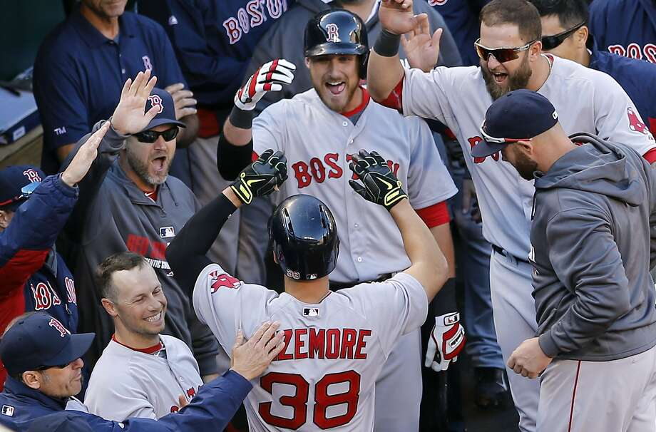 Boston's Grady Sizemore receives congratulations in the dugout after his first home run since July 15, 2011. Photo: Patrick Semansky, Associated Press