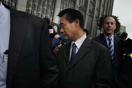 California state Sen. Leland Yee (center) leaves the Phillip Burton Federal Building and United States Courthouse with his attorney Paul DeMeester (partially seen at left) after a bond hearing on Monday, March 31, 2014, in San Francisco, Calif.