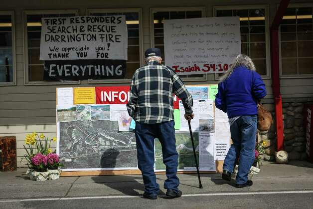 A resident reads an information board at the Darrington IGA grocery store on Monday, March 31, 2014. Work continues in the debris field of the nearby Oso mudslide. Photo: JOSHUA TRUJILLO, SEATTLEPI.COM / SEATTLEPI.COM
