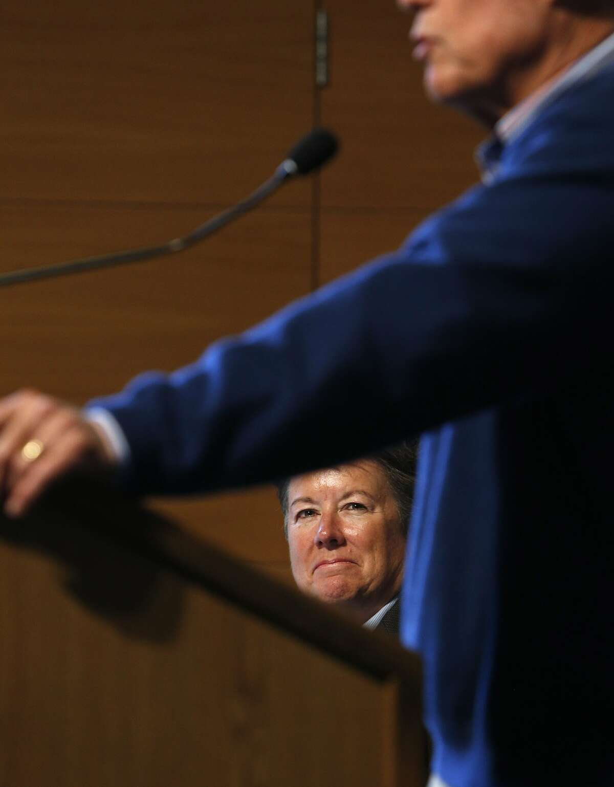 Cal Athletic Director Sandy Barbour, rear, looks up at basketball coach Mike Montgomery as he announced his retirement on Monday, March 31, 2014, at Haas Pavilion in Berkeley, Calif.