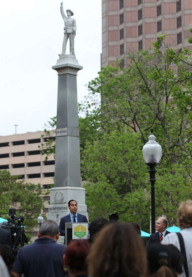 Mayor Julian Castro addresses the crowd during the City of San Antonio Travis Park reopening ceremony, Monday. On the stage on the right is Southwest Airlines CEO Gary Kelly. Photo: Jerry Lara / San Antonio Express-News / © 2014 San Antonio Express-News