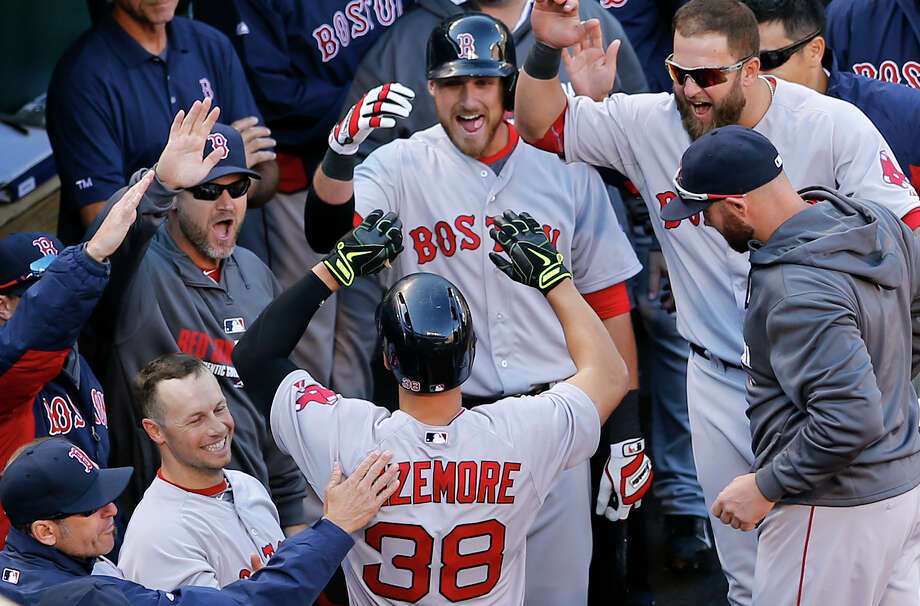 Teammates greet Boston Red Sox' Grady Sizemore (38) in the dugout after he hit a solo home run in the fourth inning of an opening day baseball game against the Baltimore Orioles, Monday, March 31, 2014, in Baltimore. (AP Photo/Patrick Semansky) ORG XMIT: MDPS112 Photo: Patrick Semansky / AP