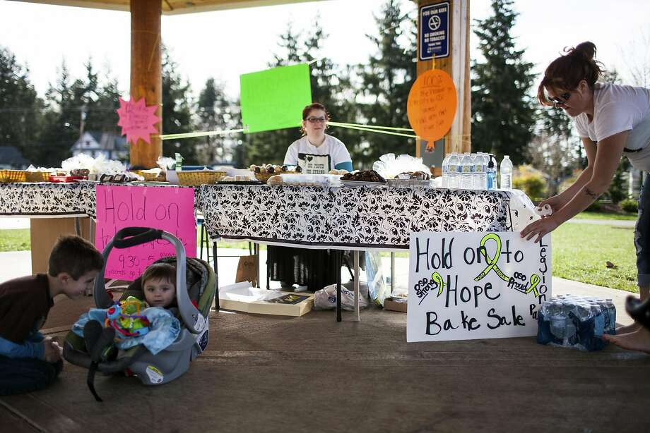 Volunteers in Arlington, Wash., sell baked goods to benefit their neighbors in the community of Oso that was devastated by the March 22 landslide. At least 22 people remain missing. Photo: Max Whittaker, Reuters
