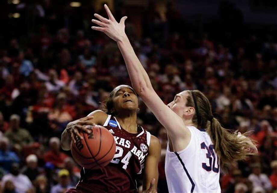 Texas A&M's Jordan Jones  (24) wins a rebound against Connecticut's Breanna Stewart (30) during  the first half of a regional final game in the NCAA college basketball  tournament in Lincoln, Neb., Monday, March 31, 2014. (AP Photo/Nati  Harnik)