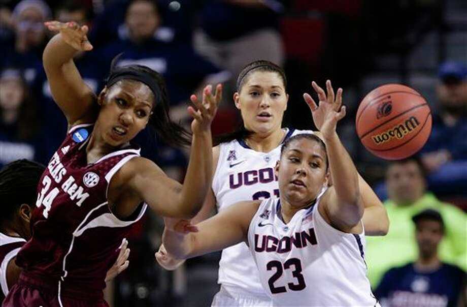 Texas A&M's Karla Gilbert  (34), Connecticut's Kaleena Mosqueda-Lewis (23) and Connecticut's  Stefanie Dolson, center rear, go for a rebound during the first half of a  regional final game in the NCAA college basketball tournament in  Lincoln, Neb., Monday, March 31, 2014. (AP Photo/Nati Harnik)