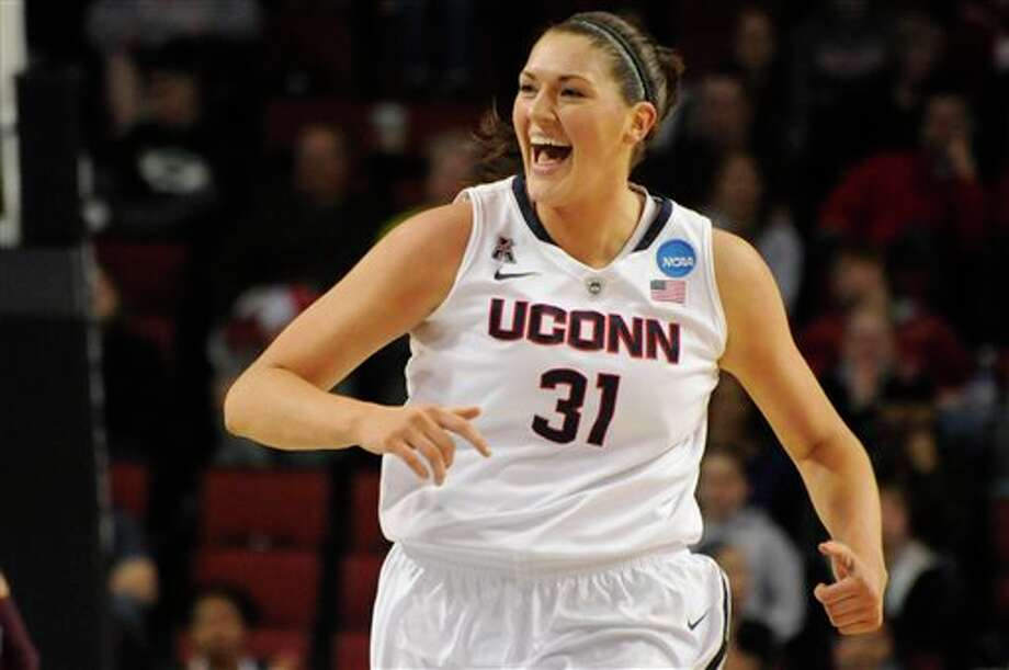 Connecticut's  Stefanie Dolson (31) during the first half of their Monday March 31,  2014, regional final against Texas A&M in the NCAA college  basketball tournament in Lincoln, Neb.(AP Photo/Dave Weaver)