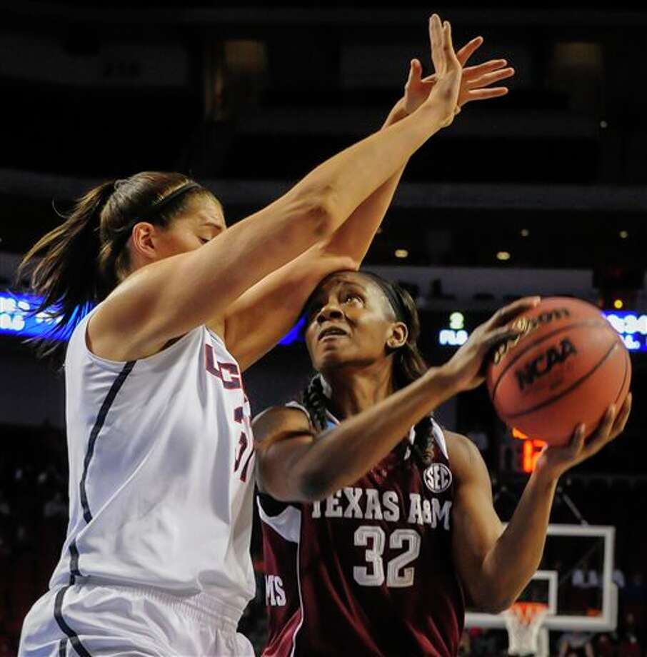 Texas A&M's Tavarsha  Scott-Williams (32) tries to get by Connecticut's Stefanie Dolson (31)  during the first half of their  regional final in the NCAA college  basketball tournament in Lincoln, Neb., Monday March 31, 2014. (AP  Photo/Dave Weaver)