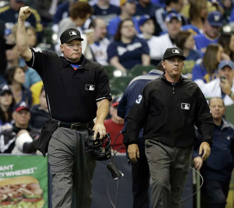 Umpire Ted Barrett (left) calls the Brewers' Ryan Braun out in the sixth after checking with central replay in New York. Photo: Jeffrey Phelps / Associated Press / FR59249 AP