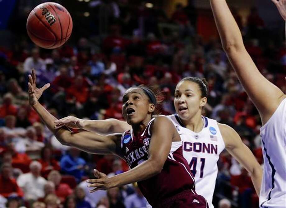 Texas A&M's Jordan Jones,  left, shoots against the defense of Connecticut's Kiah Stokes (41)  during the second half of a regional final game in the NCAA college  basketball tournament in Lincoln, Neb., Monday, March 31, 2014. (AP  Photo/Nati Harnik)