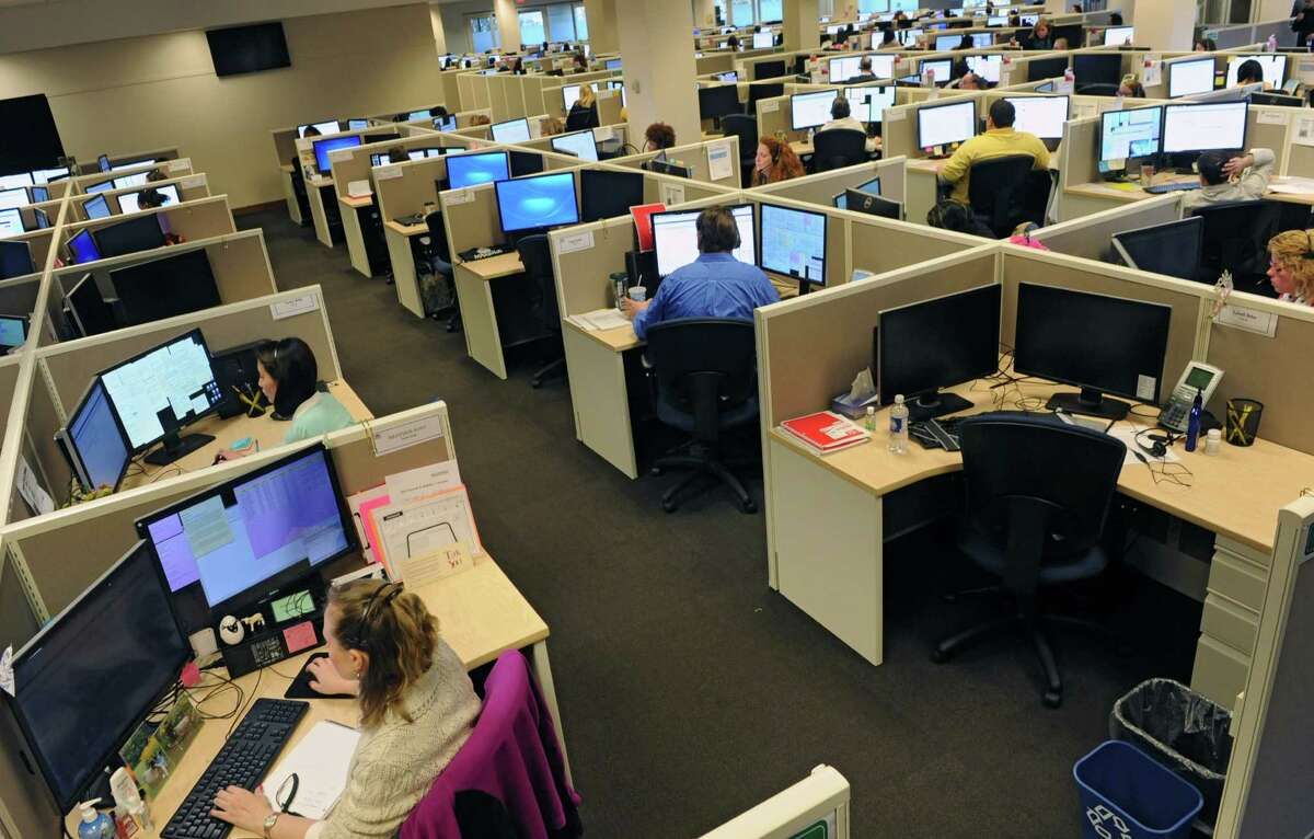 Employees of the NY State of Health Customer Service Center are busy answering calls Monday afternoon, March 31, 2014, at the state call center in Albany, N.Y. Monday was the last day to enroll in the Affordable Care Act health insurance program for this year. If you missed this deadline you would have to wait until the fall in order to enroll in the program for 2015. (Lori Van Buren / Times Union)