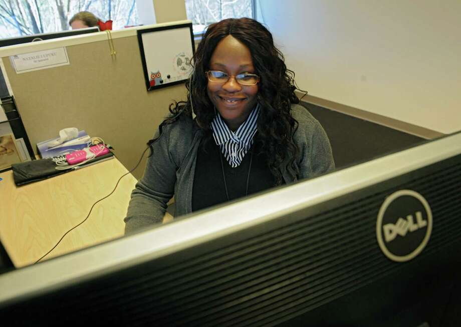 NY State of Health Customer Service Center quality control employee Natalie Lupuku of Albany is busy answering calls Monday afternoon, March 31, 2014, at the state call center in Albany, N.Y. Monday was the last day to enroll in the Affordable Care Act health insurance program for this year. If you missed this deadline you would have to wait until the fall in order to enroll in the program for 2015. (Lori Van Buren / Times Union) Photo: Lori Van Buren / 00026327A