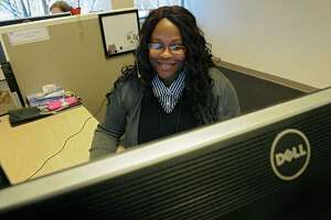 NY State of Health Customer Service Center quality control employee Natalie Lupuku of Albany is busy answering calls Monday afternoon, March 31, 2014, at the state call center in Albany, N.Y. Monday was the last day to enroll in the Affordable Care Act health insurance program for this year. If you missed this deadline you would have to wait until the fall in order to enroll in the program for 2015. (Lori Van Buren / Times Union)